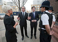 © London News Pictures. 23/03/2012. London, UK.  Liberal Democrat Leader Nick Clegg (third left) and London Liberal Democrat mayoral candidate Brian Paddick (second left) speaking to police officers and residents during a walk around the Islington, London on March 23, 2012. The Liberal Democrats  have worked with the police in the local area to reduce crime. Photo credit: Ben Cawthra/LNP