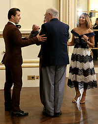 Embargoed to 0001 Saturday December 23 'Strictly Come Dancing' professional dancers Pasha Kovalev (left) and Karen Clifton (right) give guests tips on dancing during a tea dance hosted by The Duchess of Cornwall, President of the National Osteoporosis Society, at Buckingham Palace in London to highlight the benefits for older people of staying active.