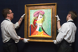 Sotheby's, London, January 28th 2016. Gallery Technicians hand Pablo Picasso's 1935 painting  Tête De Femme, which is expected to fetch between £16-20 million when it is to be auctioned by Sotheby's in London as part of their sale of Impressionist, Modern, Surrealist and Contemporary art. ///FOR LICENCING CONTACT: paul@pauldaveycreative.co.uk TEL:+44 (0) 7966 016 296 or +44 (0) 20 8969 6875. ©2015 Paul R Davey. All rights reserved.