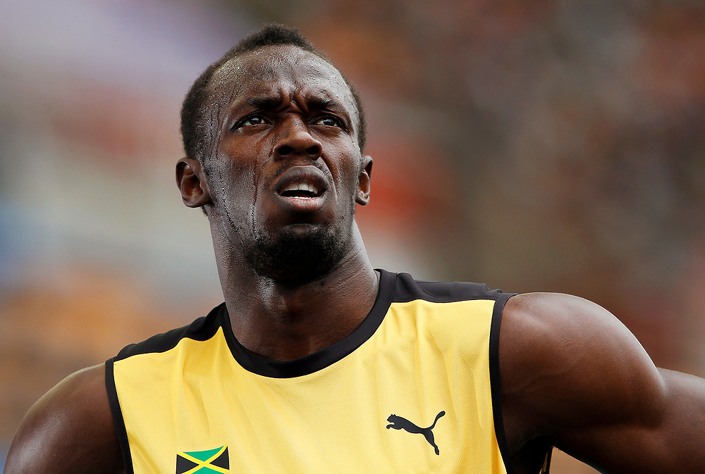 epa02892926 Usain Bolt of Jamaica pictured after competing in the men's 200m heat during the 13th IAAF World Championships in Daegu, Republic of Korea, 02 September 2011.  EPA/NIC BOTHMA