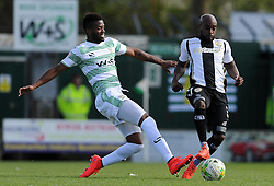 Jamal Campbell-Ryce of Notts County is tackled by Yeovil Town's Joel Grant- Photo mandatory by-line: Harry Trump/JMP - Mobile: 07966 386802 - 11/04/15 - SPORT - FOOTBALL - Sky Bet League One - Yeovil Town v Notts County - Huish Park, Yeovil, England.