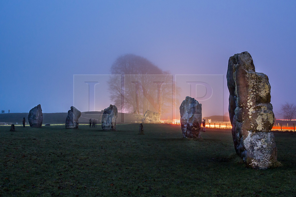 © Licensed to London News Pictures 21/12/2017, Avebury, UK. People start to gather at the Stone circle in Avebury on a dark misty morning for the rising of the sun on the shortest day of the year, the winter solstice . Photo Credit : Stephen Shepherd/LNP