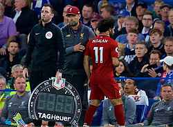 LONDON, ENGLAND - Saturday, September 29, 2018: Liverpool's Mohamed Salah is replaced by substitute Xherdan Shaqiri by manager Jürgen Klopp during the FA Premier League match between Chelsea FC and Liverpool FC at Stamford Bridge. (Pic by David Rawcliffe/Propaganda)