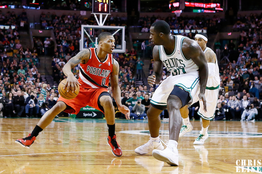 30 November 2012: Portland Trail Blazers point guard Damian Lillard (0) dribbles in front of Boston Celtics power forward Brandon Bass (30) during the Boston Celtics 96-78 victory over the Portland Trail Blazers at the TD Garden, Boston, Massachusetts, USA.