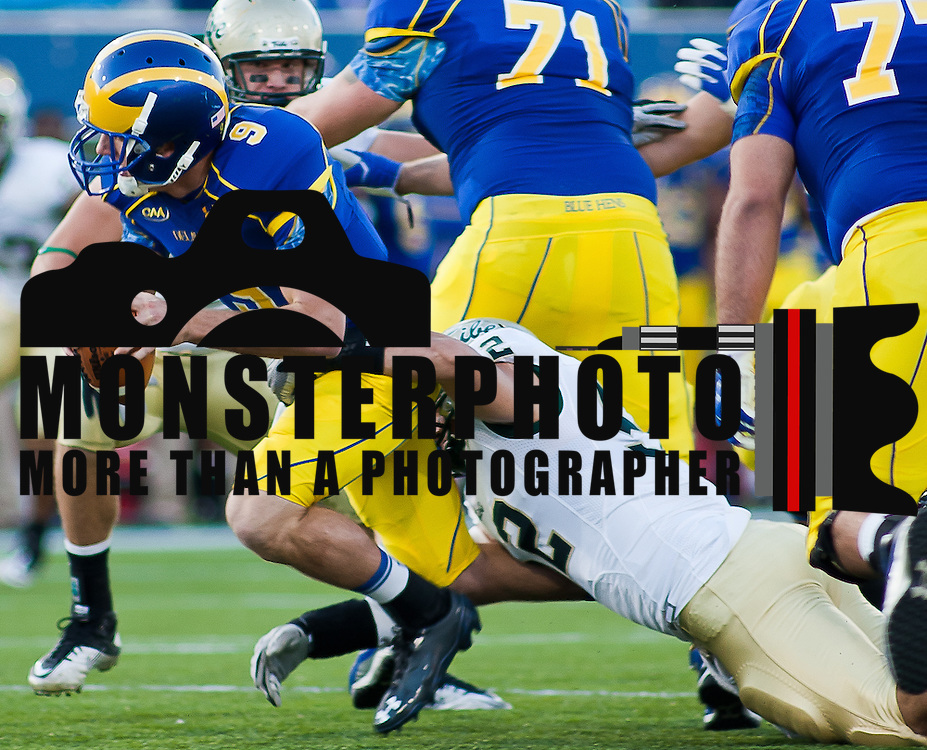 Delaware Quarterback Tim Donnelly #9 gets sack in the back field by William & Mary Marcus Hyde #52 during a Week 6 NCAA football game against William & Mary. ..Delaware defeated William & Mary 21- 0 in front of 17, 808 fans at Delaware Stadium on Saturday Oct. 08, 2011 in Newark DE...(Monsterphoto/Saquan Stimpson)
