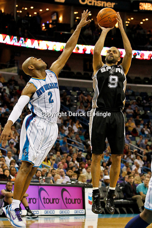 January 23, 2012; New Orleans, LA, USA; San Antonio Spurs point guard Tony Parker (9) shoots over New Orleans Hornets point guard Jarrett Jack (2) during the second half of a game at the New Orleans Arena. The Spurs defeated the Hornets 104-102.  Mandatory Credit: Derick E. Hingle-US PRESSWIRE