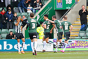 Plymouth Argyle's Curtis Nelson celebrates scoring a goal with his team mates to make it 1-1 during the Sky Bet League 2 match between Plymouth Argyle and Oxford United at Home Park, Plymouth, England on 5 March 2016. Photo by Graham Hunt.