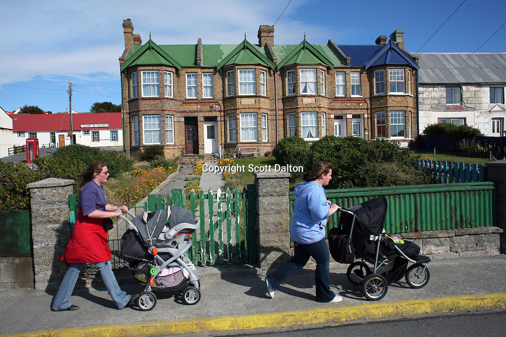Two babies are pushed along in strollers on the streets of Stanley, the capital of the Falkland Islands, on Wednesday, March 21, 2007. This year is the 25 anniversary of the war for sovereignty of the islands between the United Kingdom and Argentina. The two-month war resulted in the withdrawal of Argentinean forces and the islands remained part of the United Kingdom. After the war the islands there has been strong economic development. (Photo/Scott Dalton)