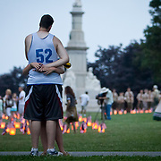 Scott Friedlander, 17, and Katelynn Tucker, 19, embrace as dusk settles in at the Soldiers National Cemetery, during the Sesquicentennial Anniversary of the Battle of Gettysburg, Pennsylvania on Sunday, June 30, 2013.  The two traveled from Attleboro, Massachussets, as Friedlander was participating in his first battle reenactment.