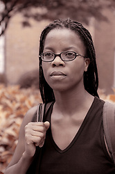 Portrait of young woman wearing glasses standing outside,