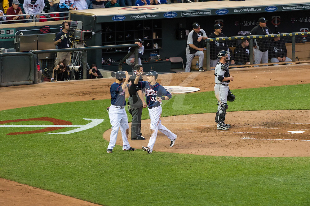 Joe Mauer #7 and Justin Morneau #33 of the Minnesota Twins celebrate after scoring against the Chicago White Sox on May 13, 2013 at Target Field in Minneapolis, Minnesota.  The Twins defeated the White Sox 10 to 3.  Photo: Ben Krause