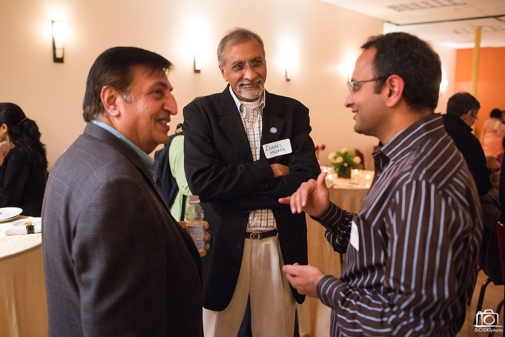 Idrees Munir, center, talks with colleagues during the World Culture Festival Bay Area Curtain Raiser event at the India Community Center in Milpitas, California, on January 20, 2016. (Stan Olszewski/SOSKIphoto)