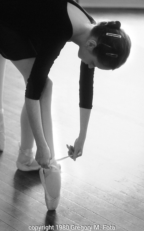 Ballet Class-Tying Slippers --Ballet Guild of the Lehigh Valley dance studio, Main Street, Bethlehem,PA. April13, 1980.
