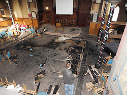 View of the interior of the Derby Road Baptist church, Watford, after an arson attack Saturday Feb.1, 2014, United Kingdom. Photo taken Sunday, 2nd February 2014, the colored tapes round the posts, right, were for an upcoming wedding. Picture by Max Nash / i-Images