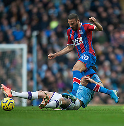 John Stones of Manchester City (L) tackles Cenk Tosun of Crystal Palace  - Mandatory by-line: Jack Phillips/JMP - 18/01/2020 - FOOTBALL - Etihad Stadium - Manchester, England - Manchester City v Crystal Palace - English Premier League