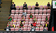 Watford substitutes sit apart from each other during the Premier League match at Vicarage Road, Watford. Picture date: 20th June 2020. Picture credit should read: Darren Staples/Sportimage