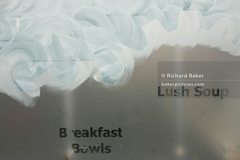 The stencilled words 'lush soup & breakfast bowls' have been left on a lunchtime food business after a recession closure