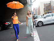 Annie Greenberg, senior style editor at Refinery 29, keeps an eye on the weather with the AccuWeather MinuteCast street team at New York Fashion Week, on Saturday, Sept. 12, 2015. The AccuWeather MinuteCast Street Team is at it again helping Fashion Week attendees stay stylish and one-step ahead of any possible precipitation. (Photo by Diane Bondareff/Invision for AccuWeather/AP Images)