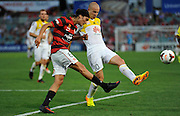 01.01.2014 Sydney, Australia. Wanderers German midfielder Jérome Polenz and Wellingtons forward Stein Huysegems in action during the Hyundai A League game between Western Sydney Wanderers FC and Wellington Phoenix FC from the Pirtek Stadium, Parramatta. Wellington won 3-1.