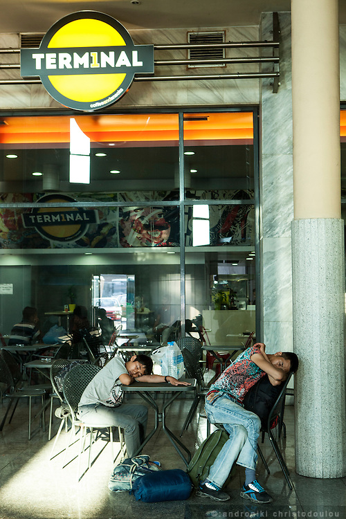 Refugees taking a nap at thecoffee shop of Thessaloniki intercity bus station. <br /> Refugees often arrive to Thessaloniki by train and then they go to the intercity bus station to board on the bus to Eidomeni border where they can cross to the Republic of Macedonia on foot.