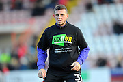 Pierce Sweeney (31) of Exeter City warming up wearing a Kick It Out T-Shirt before the EFL Sky Bet League 2 match between Exeter City and Luton Town at St James' Park, Exeter, England on 26 November 2016. Photo by Graham Hunt.