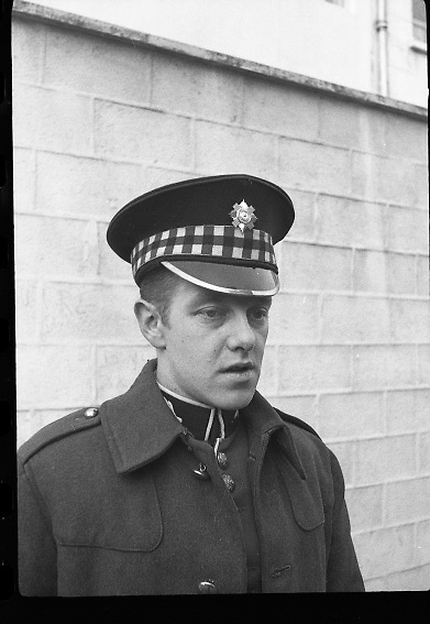Peter Hughes in Guard Uniform.   B269..1960..06.01.1960..01.06.1960..6th January 1960..Pictured strolling through Dublin was Mr Peter Hughes resplendent in his Guards Uniform...Portrait of Peter in uniform.