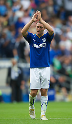 CARDIFF, WALES - Sunday, August 8, 2010: Cardiff City's Darcy Blake applauds the supporters during the League Championship match against Sheffield United at the Cardiff City Stadium. (Pic by: David Rawcliffe/Propaganda)