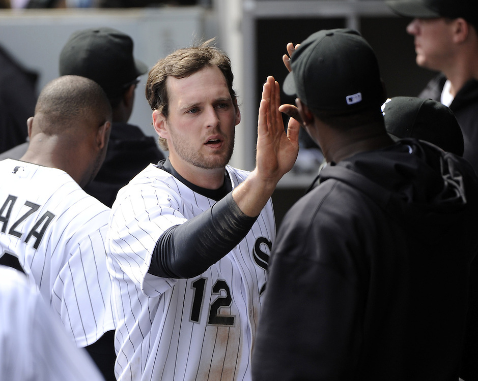 CHICAGO - APRIL 06:  Conor Gillaspie #12 of the Chicago White Sox celebrates with teammates after scoring in the seventh inning against the Seattle Mariners  on April 06, 2013 at U.S. Cellular Field in Chicago, Illinois.  The White Sox defeated the Mariners 4-3.  (Photo by Ron Vesely)   Subject:  Conor Gillaspie