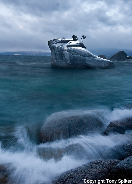 """Bonsai Rock Stormy Morning 1"" - A photograph of clouds rolling over Lake Tahoe at Bonsai Rock, on Lake Tahoe's Eastern shore"