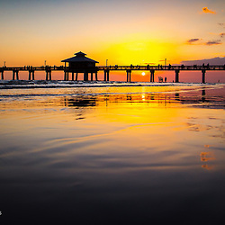 Ft Myers Beach fishing pier at sunset