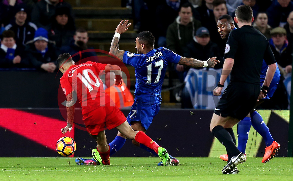 Philippe Coutinho of Liverpool treads on the ankle of Danny Simpson of Leicester City twisting it awkwardly - Mandatory by-line: Robbie Stephenson/JMP - 27/02/2017 - FOOTBALL - King Power Stadium - Leicester, England - Leicester City v Liverpool - Premier League