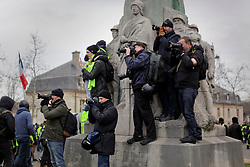 19 January 2019. Paris, France.<br /> Gilets Jaunes - Acte X take to the streets of Paris. Press photographers cover the protest. An estimated 7,000 people took part in the looping 14 km route from Place des Invalides to protest tax hikes from the Government of Emmanuel Macron imposed on the people. An estimated 80,000 people took part in protests across the country. Regrettably the movement has attracted a violent element of agitators who often face off with riot police at the end of the marches which tends to deflect attention away from the message of the vast majority of peaceful protesters.<br /> Photo&copy;; Charlie Varley/varleypix.com