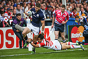 Scotland's Tommy Seymour is tackled by Japan's Kenki Fukuoka during the Rugby World Cup Pool B match between Scotland and Japan at the Kingsholm Stadium, Gloucester, United Kingdom on 23 September 2015. Photo by Shane Healey.