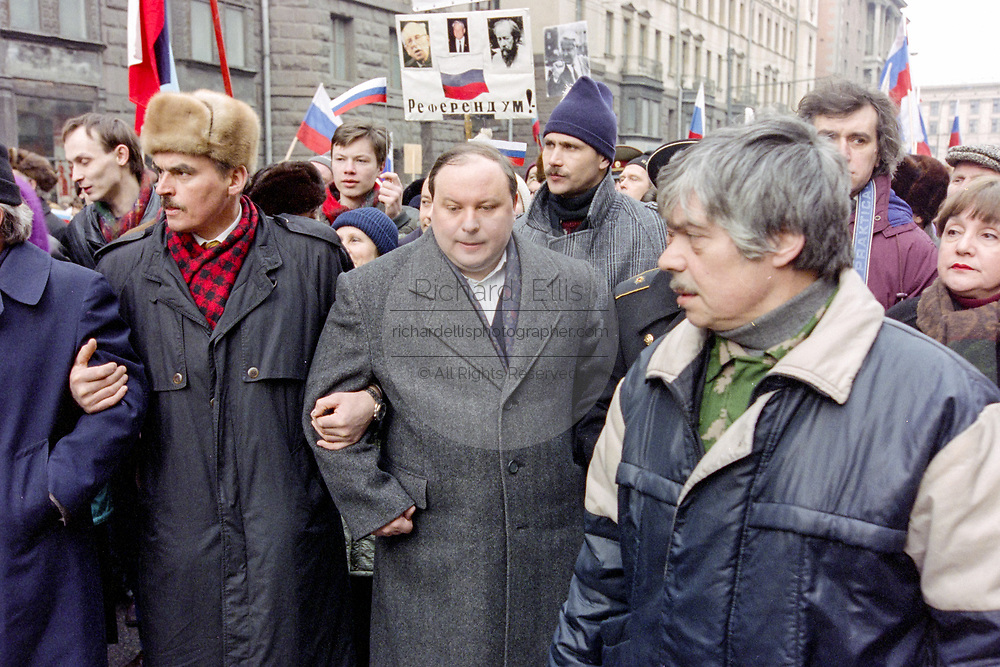 Former acting Russian Prime Minister Yegor Gaidar, center,  leads a mass demonstration in support of President Boris Yeltsin March 28, 1993 in Moscow, Russia. Thousands marched through central Moscow ending in Red Square where Yeltsin addressed the crowd.