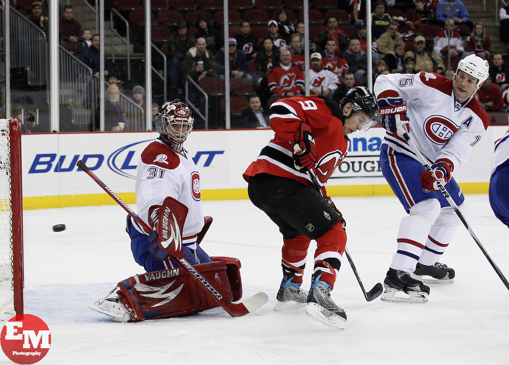 Dec 16, 2009; Newark, NJ, USA; Montreal Canadiens goalie Carey Price (31) makes a save through a screen by New Jersey Devils left wing Zach Parise (9) during the second period at the Prudential Center.