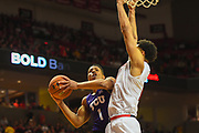 LUBBOCK, TX - MARCH 3: Desmond Bane #1 of the TCU Horned Frogs goes to the basket against Zach Smith #11 of the Texas Tech Red Raiders during the game on March 3, 2018 at United Supermarket Arena in Lubbock, Texas. Texas Tech defeated TCU 79-75. Texas Tech defeated TCU 79-75. (Photo by John Weast/Getty Images) *** Local Caption *** Desmond Bane;Zach Smith