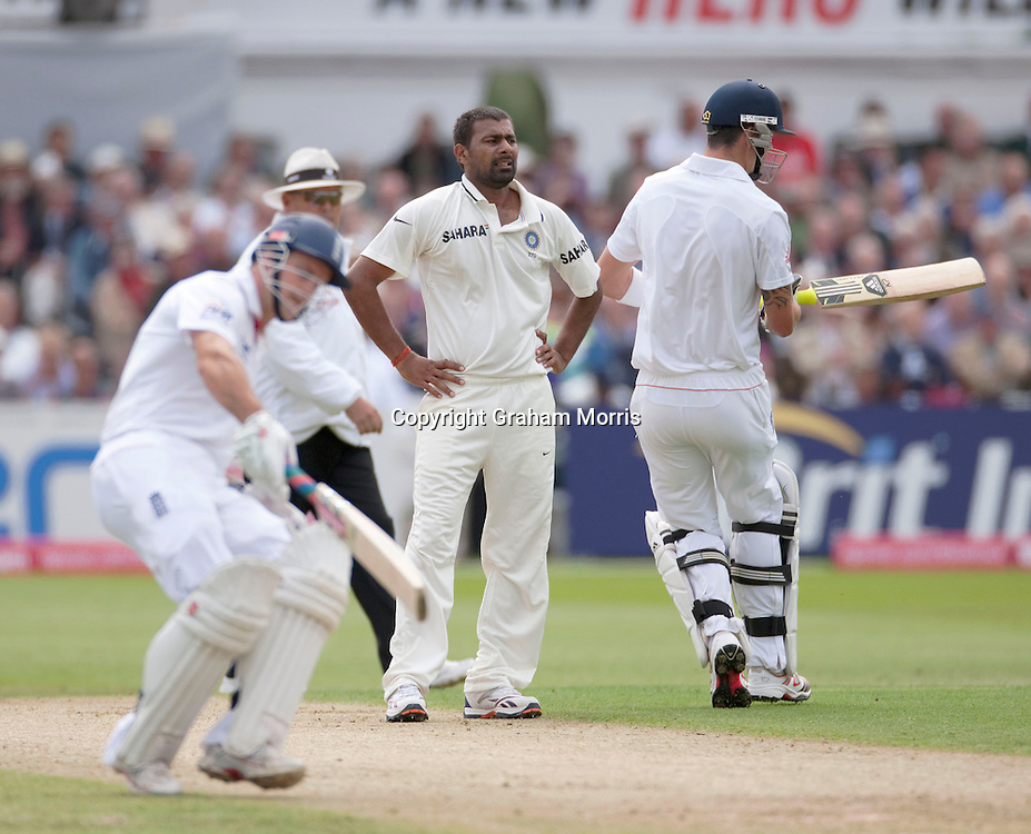 Praveen Kumar as Kevin Pietersen and Andrew Strauss run off his bowling during the second npower Test Match between England and India at Trent Bridge, Nottingham.  Photo: Graham Morris (Tel: +44(0)20 8969 4192 Email: sales@cricketpix.com) 29/07/11