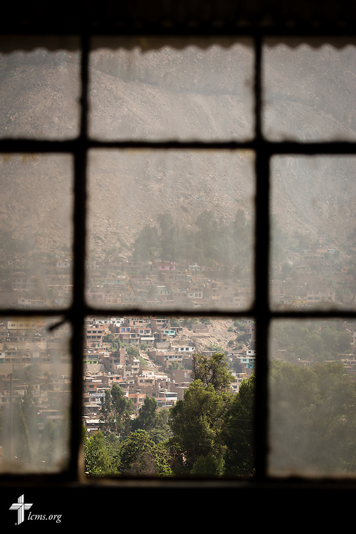 Homes and businesses are seen from a window of the Noe (Spanish for Noah) school near Lima, Peru, on Tuesday, April 7, 2015. LCMS Communications/Erik M. Lunsford