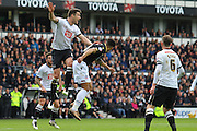 Derby defender Jason Shackell challenges for the ball with Bolton forward Kaiyne Woolery during the Sky Bet Championship match between Derby County and Bolton Wanderers at the iPro Stadium, Derby, England on 9 April 2016. Photo by Aaron  Lupton.