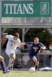 01 October 2006: Titan Steve Perona and Crusader Robbie Burton challenge for possession. The game remained scoreless until the 2nd overtime in which University of Dallas Crusaders Adam Lunger scored the Golden Goal to beat the Illinois Wesleyan Titans.  This game was played at Neis Field on the campus of Illinois Wesleyan University in Bloomington Illinois.