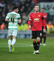 Yeovil Town's Joe Edwards and Manchester United's Wayne Rooney  - Photo mandatory by-line: Joe meredith/JMP - Mobile: 07966 386802 - 04/01/2015 - SPORT - football - Yeovil - Huish Park - Yeovil Town v Manchester United - FA Cup - Third Round