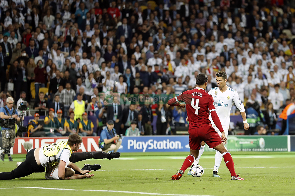 (L-R) steward, pitch intruder, Virgil van Dijk of Liverpool FC, Cristiano Ronaldo of Real Madrid during the UEFA Champions League final between Real Madrid and Liverpool on May 26, 2018 at NSC Olimpiyskiy Stadium in Kyiv, Ukraine