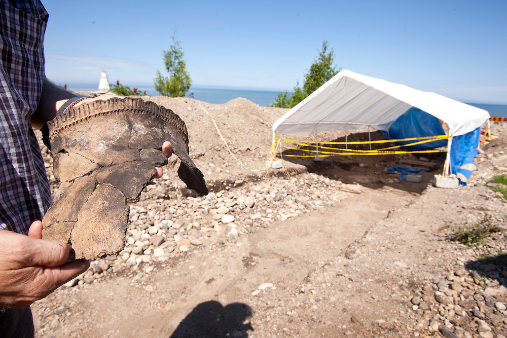 London, Ontario ---10-07-20--- Archeologist Bill Fitzgerald holds one of the artifacts unearthed at the site of an archeological dig at the mouth of the Saugeen River in Southampton, Ontario, July 20, 2010.<br /> GEOFF ROBINS The Globe and Mail