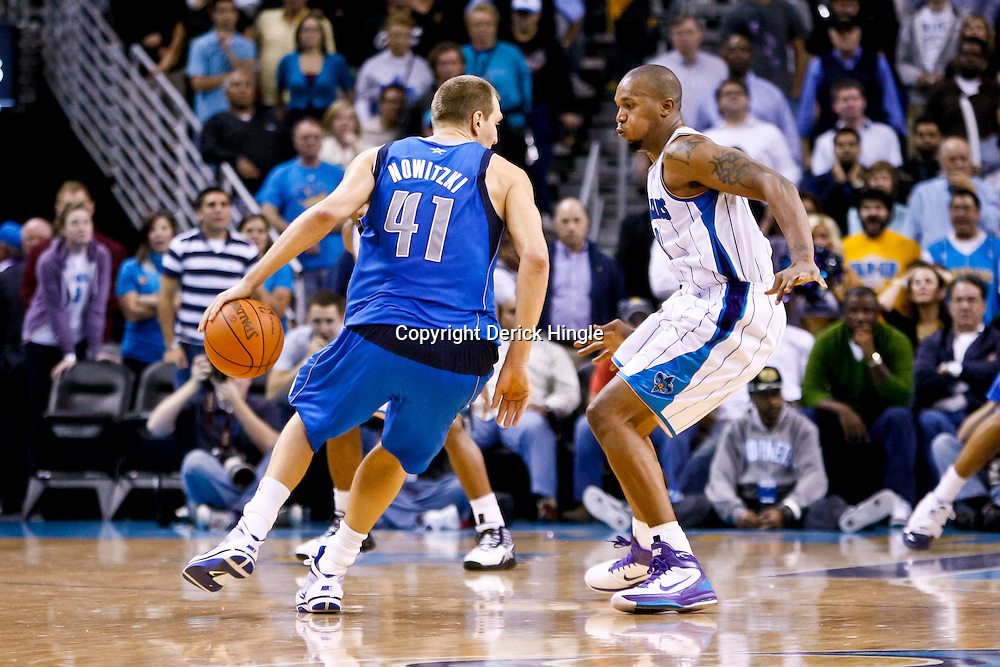 November 17, 2010; New Orleans, LA, USA; Dallas Mavericks power forward Dirk Nowitzki (41) of Germany is guarded by New Orleans Hornets power forward David West (30) during a game at the New Orleans Arena. The Hornets defeated the Mavericks 99-97. Mandatory Credit: Derick E. Hingle