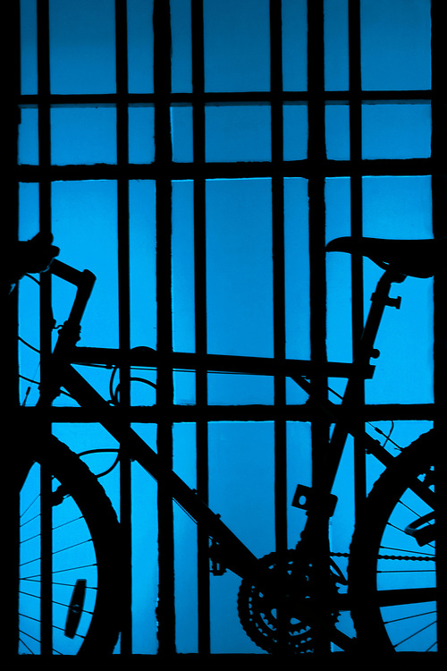 A bicycle on light blue window