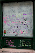 Detail of handwritten messages in the window of a Covent Garden restaurant, temporarily closed for a refurbishment, on 22nd February 2017, on Garrick Street, in London England.