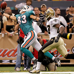 2009 September 03: Miami Dolphins wide receiver Greg Camarillo (83) attempts to make a catch as New Orleans Saints cornerback Malcolm Jenkins (27) covers during a preseason game between the Miami Dolphins and the New Orleans Saints at the Louisiana Superdome in New Orleans, Louisiana.