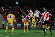 Ryan Jennings heads over the bar during the Vanarama National League match between Cheltenham Town and Chester City at Whaddon Road, Cheltenham, England on 5 December 2015. Photo by Antony Thompson.
