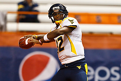 Oct 21, 2011; Syracuse NY, USA;  West Virginia Mountaineers quarterback Geno Smith (12) warms up before the game against the Syracuse Orange at the Carrier Dome.  Mandatory Credit: Jason O. Watson-US PRESSWIRE