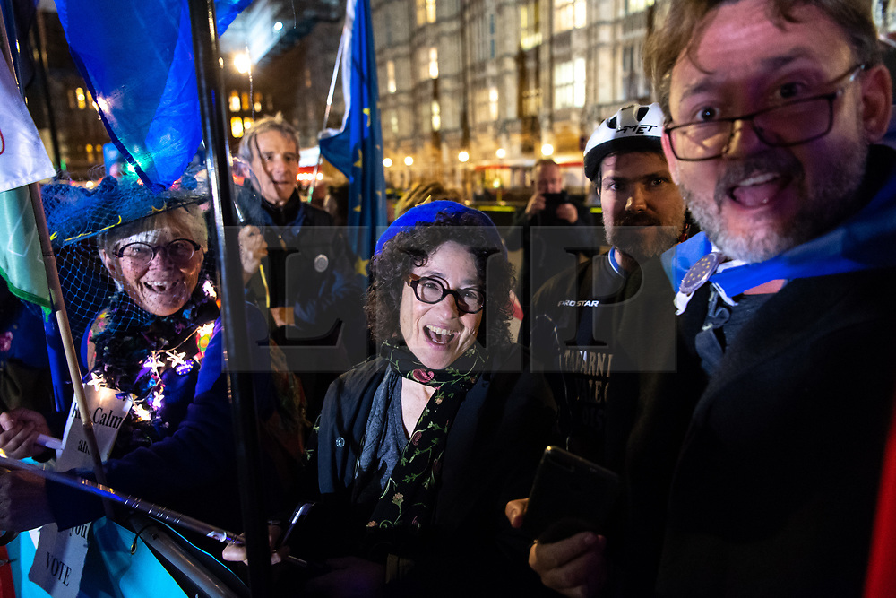 "© Licensed to London News Pictures. 22/10/2019. London, UK. People react outside The Palace of Westminster in front of College Green following crucial votes for PM Boris Johnson government. MPs backed his Withdrawal Agreement Bill - but minutes later voted against the timetable, placing Brexit ""in limbo"". Photo credit: Guilhem Baker/LNP"